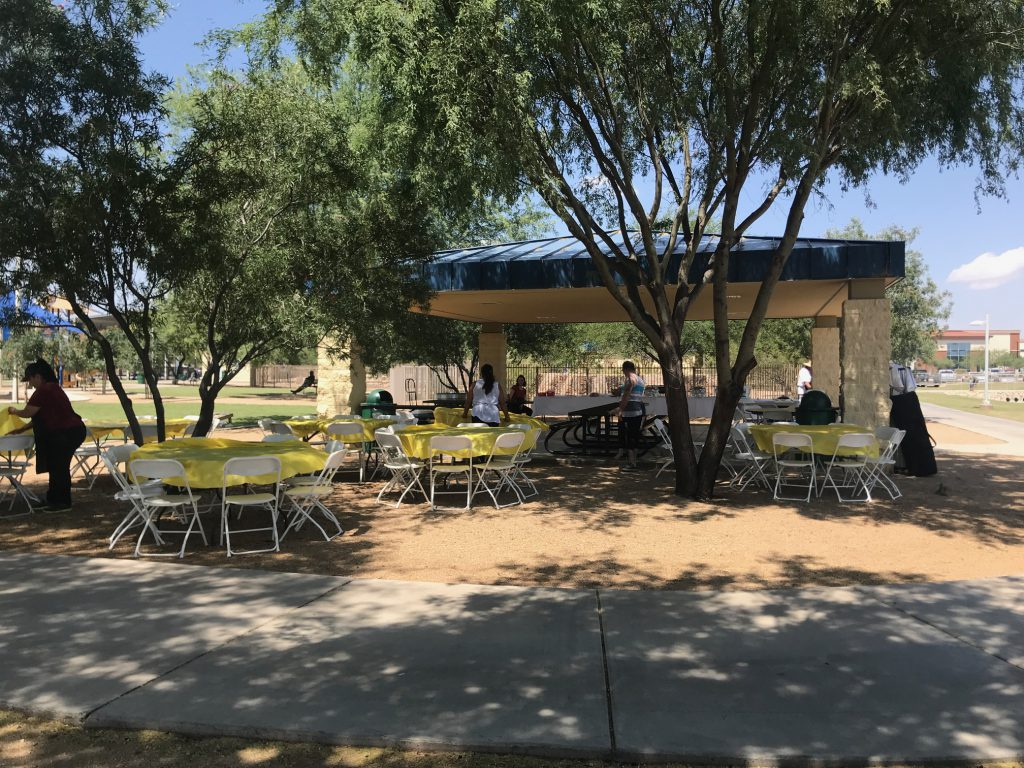 Tables and chairs are set up around a well-kept Marana park gazebo for our Kappcon Summer BBQ. Plenty of shade and space to relax, have fun, and cool off for our hard working employees.